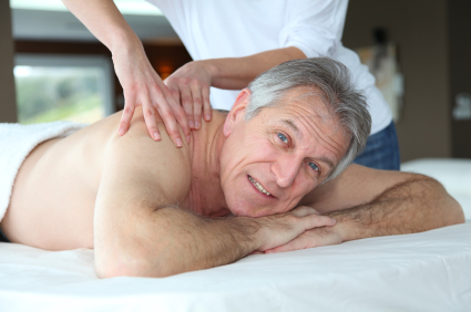 senior adult man getting massage