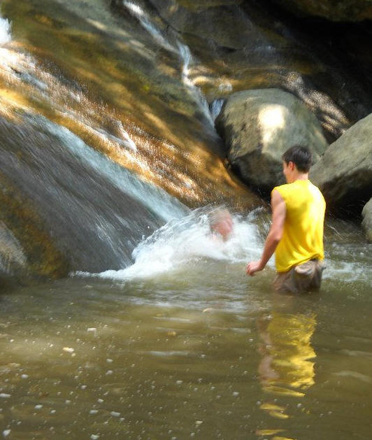 children playing in waterfall
